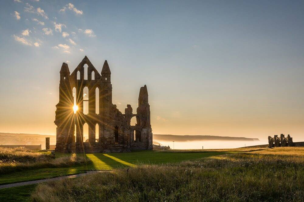 whitby abbey in yorkshire at sunset