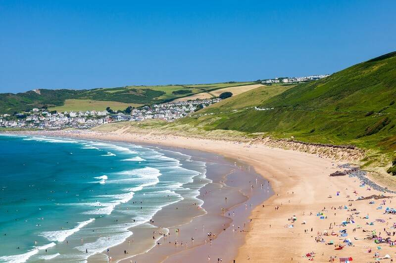 Devon Beach in South West UK with rolling hills in the background