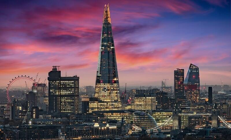 London skyline, featuring the Shard building, with a blue and purple sky