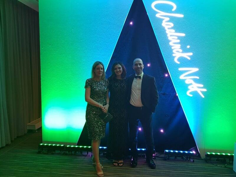Gloucestershire & Wiltshire awards staff photo with signage