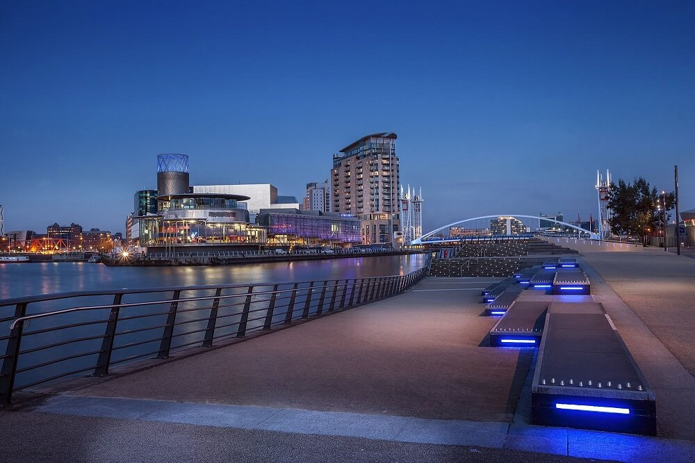 manchester city skyline at night by the river