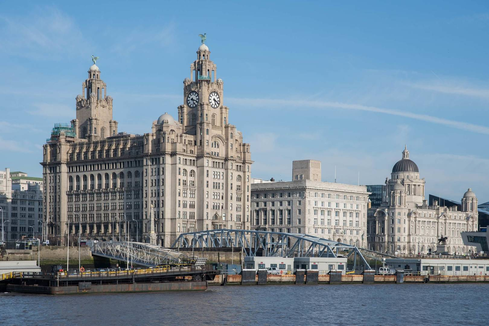 buildings in liverpool against a blue sky