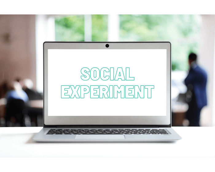 laptop screen in an office displaying the words social experiment